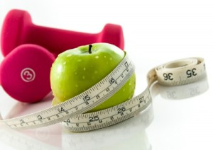 healthy food and tape measure representing weight loss